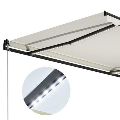 vidaXL Markis manuellt infällbar med LED 600x300 cm gräddvit