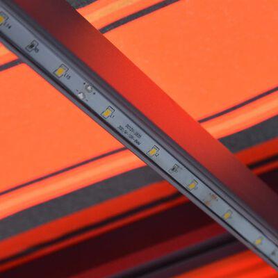 vidaXL Markis manuellt infällbar med LED 600x300 cm orange och brun